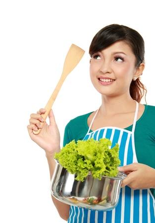 Młoda kobieta, myśląc o czymś gotować Zdjęcie Seryjne