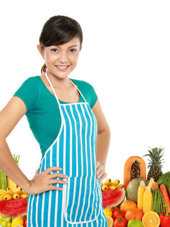 Young smiling woman with fruits and vegetables isolated Over white background Stock Photo - 12371518