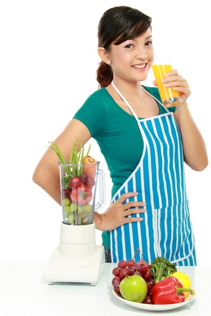 Portrait of a woman having a glass of fresh juice isolated over white background Stock Photo - 12371530