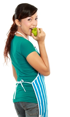 Young woman with an apple against white background photo