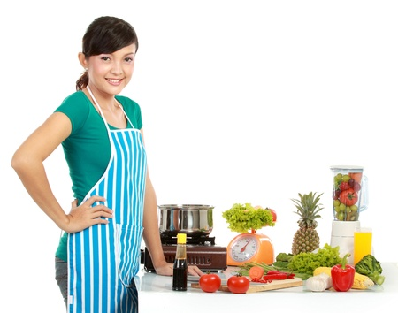 Beautiful woman preparing ingredient  on the table to cook something
