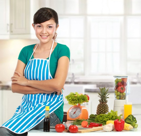Beautiful woman preparing ingredient  on the table to cook something photo