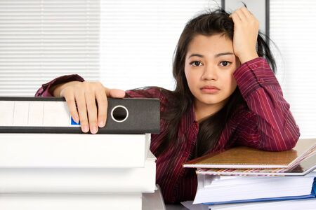 going crazy: asian business woman feeling stress at work