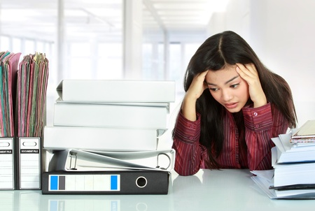 business stress: Portrait of stress business woman in the office Stock Photo