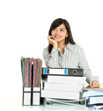 undersign: Portrait of young business woman thinking with many document on the table