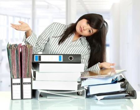 undersign: Portrait of young business woman showing document on the table Stock Photo