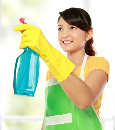housecleaning: portrait of asian woman holding a sprayer. ready for cleaning