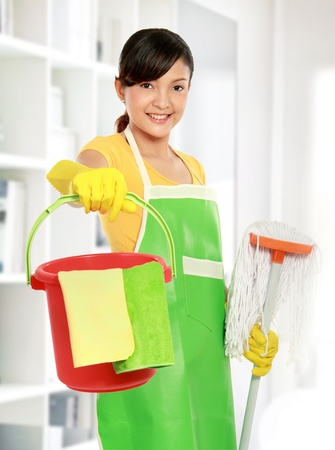 bright housekeeping: portrait of beautiful asian woman with cleaning equipment
