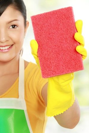 rubber gloves: portrait of Attractive young woman cleaning windows isolated over white background
