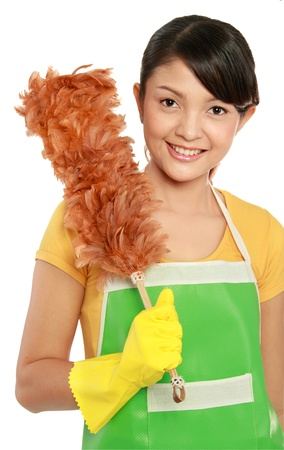 bright housekeeping: portrait of beautiful asian woman with cleaning duster isolated over white background Stock Photo