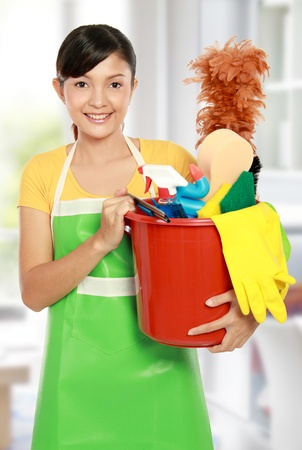 portrait of beautiful asian woman with many cleaning equipment photo
