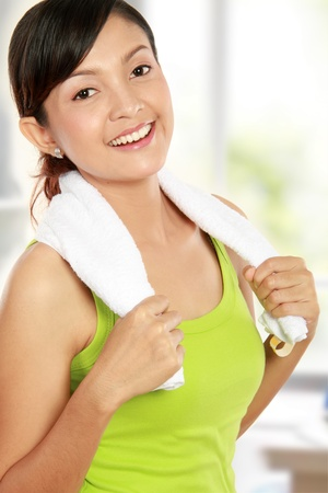 Portrait of healthy fitness woman with towel smiling photo