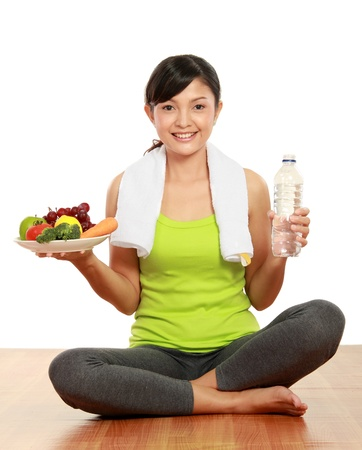 close up portrait of healthy fitness woman carrying a group of healthy food and water Stock fotó