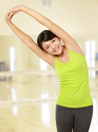 healthy fitness woman stretching in the gym Stock Photo - 12371684