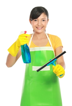 wipe: portrait of Attractive young woman cleaning windows. Stock Photo