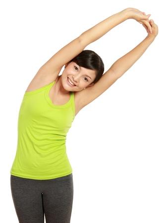растягивание: Здоровая женщина растяжения фитнес Фото со стока