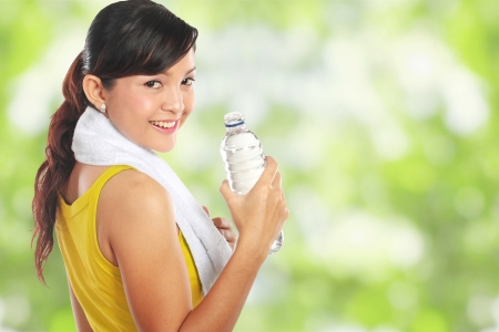 healthy person: Portrait of healthy fitness woman holding a bottle of water