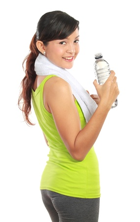 girl in sportswear: healthy fitness woman drinking a bottle of water isolated on white background