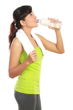 water aerobics: Portrait of healthy fitness woman drinking a bottle of water Stock Photo