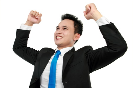 Cheerful asian business man with arms raised in success isolated on white background Stock Photo - 12799120