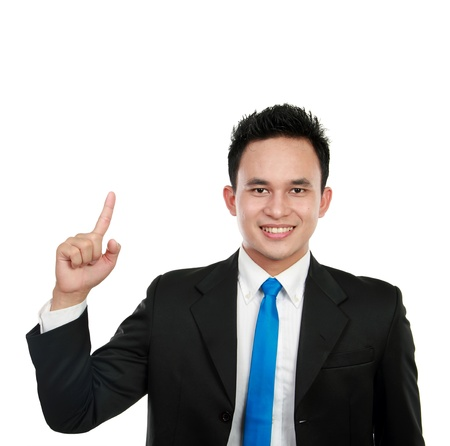 asian business man pointing up to blank copy space studio isolated on white background photo