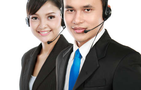 Closeup of call center employee smiling with colleague in background photo