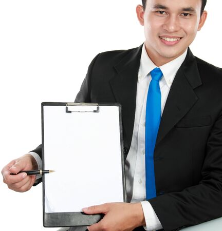 smiling young business man showing blank clipboard, isolated on white background photo