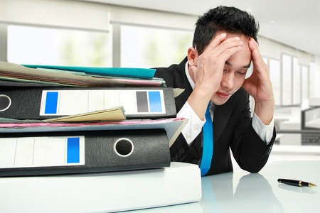 Portrait of busy businessman stressed at work Stock Photo