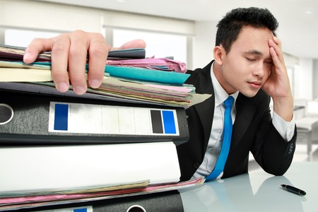 business stress: Portrait of busy businessman stressed at work Stock Photo