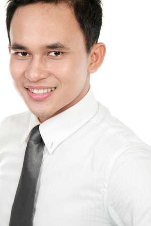 Closeup portrait of a happy young asian business man smiling on white background photo