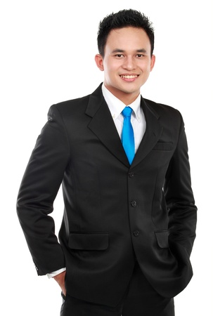 Closeup portrait of a happy young asian businessman smiling on white background photo