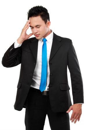 Business man having stress. Isolated over white background photo