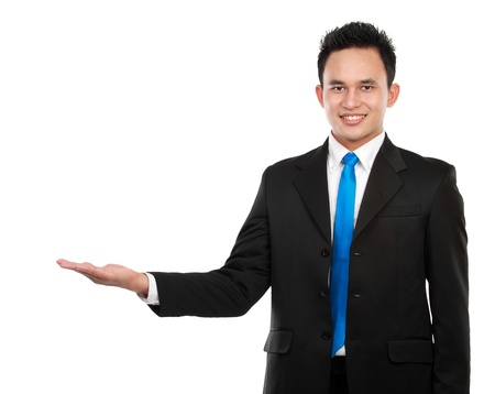 presenting: Business man presenting copyspace over a white background