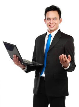 Portrait of a smiling asian business man with a laptop isolated on white background Stock Photo