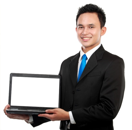 Smiling businessman showing a blank laptop against a white background photo
