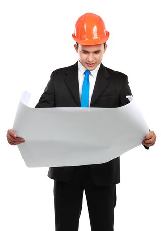 confident Handsome young asian man architect looking at paper work isolated over white background photo