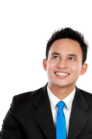 1 person: Primer plano de hombre de negocios mirando a su texto y sonriente Foto de archivo