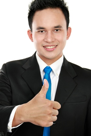 young asian business man showing thumbs up sign photo