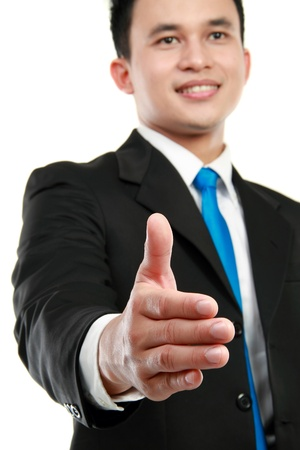 offering: successful man extending hand to shake isolated on white background