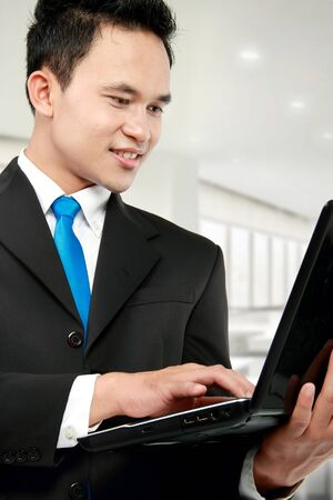 young business man using laptop at the office photo