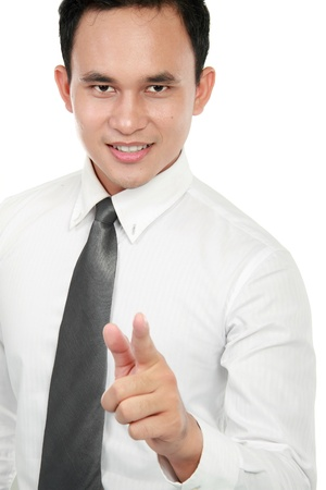 Portrait of a smiling young business man pointing at you over white background Stock Photo - 12809597