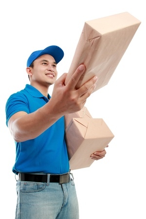 Young man courier in blue uniform with packages isolated on white background Stock Photo - 12809594