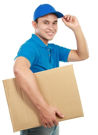 Young man courier in blue uniform with packages isolated on white photo