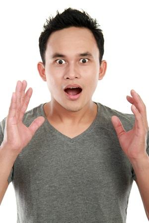 Expressive happy surprised man isolated on white background photo