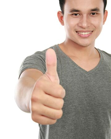 young asian man showing thumbs up sign photo