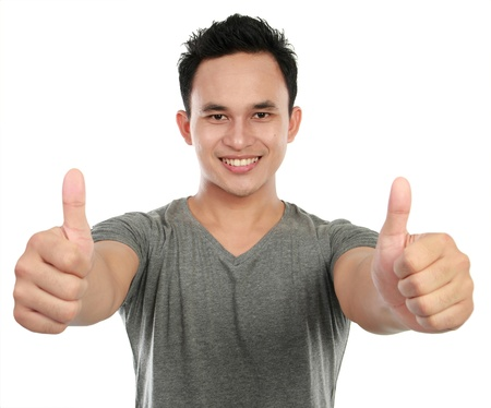 male's thumb: young asian man showing two thumbs up sign Stock Photo