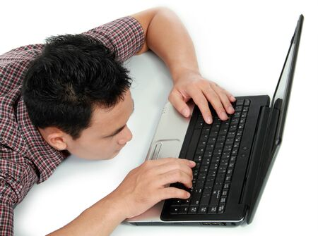Tired man with head down on laptop photo