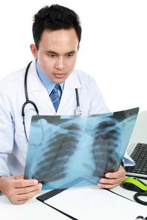 torax: potrait of asian doctor looking at x ray Stock Photo