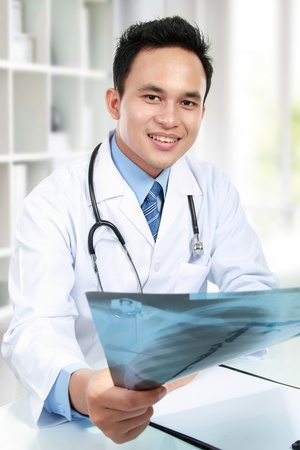 radiologist: potrait of doctor giving the x ray Stock Photo