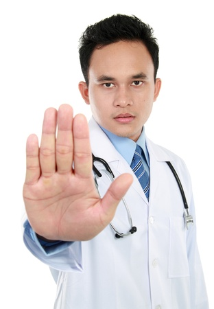 Young medic doctor making stop sign isolated over white background photo